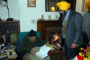 Presenting an advance copy of Sikh Heritage: Ethos and Relics to Khushwant Singh