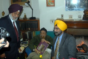 Bhayee Sikandar Singh and Roopinder Singh presenting an advance copy of Sikh Heritate: Ethos and Relics to Khushwant Singh