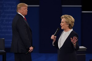 Hillary Clinton speaks while Donald Trump glowers during a televised debate.